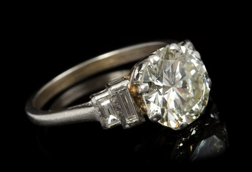 Lot 604-Fine Art Deco diamond single stone ring, the old...