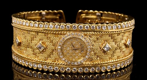 Lot 584-Fine Etoile gold (18ct) and diamond set bracelet...