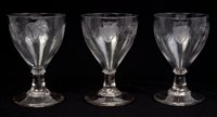 Lot 32 - Three George III rummers, each engraved with...