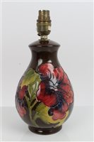 Lot 2048 - Moorcroft Pottery lamp decorated in the...