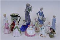 Lot 2053 - Nine Royal Doulton figures - Babie HN1679,...