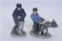 Lot 2055 - Two Royal Copenhagen figures - boy with dog no....