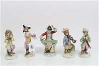 Lot 2087 - Five piece porcelain 'monkey band' - some with...