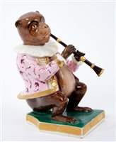 Lot 21-Early 19th century Derby figure of a monkey...
