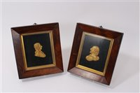 Lot 655-Pair of 19th century gilt metal profile...