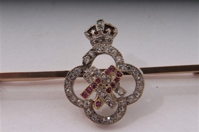 Lot 8-HM Queen Alexandra – fine gold, diamond, ruby and enamel presentation bar brooch, 4.5cm long