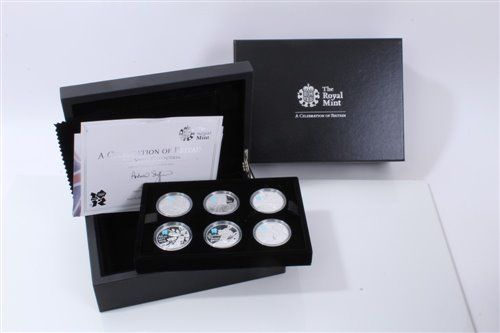 Lot 17-G.B. The Royal Mint Silver Proof Coin Set – containing six Five Pound coins dated 2010, obverse by designer – Ian Rank-Bradley and reverse by designer – Shane Greeves – 'A Celebration of Britain –...