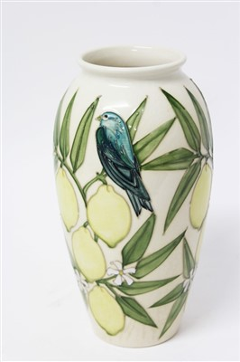 Lot 2040-Contemporary Moorcroft Pottery vase decorated with bird and lemons on cream ground