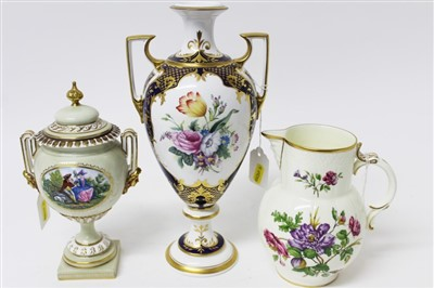 Lot 2043-Royal Worcester urn shaped two handled vase with cover, Royal Worcester 2002 Heritage Collection floral jug and a Spode limited edition urn shaped two handled vase, number 15