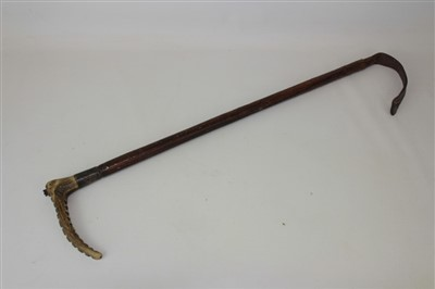 Lot 838-Early 20th century silver mounted Swaine & Co, London hunting whip with horn handle