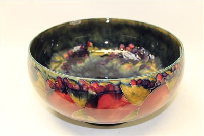 Lot 2001-Large Moorcroft pottery bowl decorated in the Pomegranate pattern, impressed marks and green painted signature to base, 30cm diameter