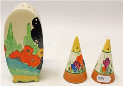 Lot 2002-Pair of Clarice Cliff Crocus pattern salt and pepper pots and a Clarice Cliff Bonjour sugar sifter (3)