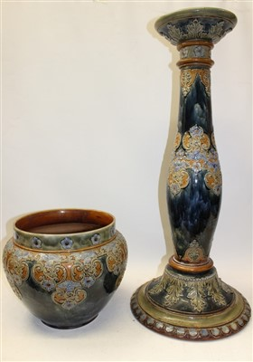 Lot 2020-Large Royal Doulton stoneware jardinière on stand with applied floral decoration on mottled green and blue ground – impressed marks to base
