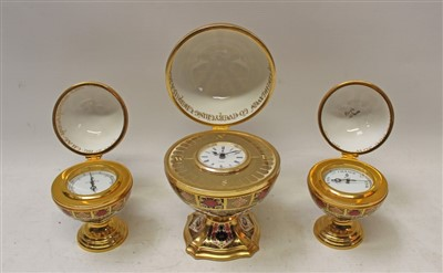 Lot 2023-Royal Crown Derby limited edition Millennium Globe Clock, commissioned by Sinclairs, Royal Crown Derby limited edition Millennium clock and barometer, all no. 639 of 1000, all boxed with certificat...
