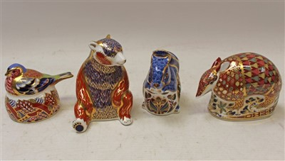 Lot 2031-Four Royal Crown Derby paperweights – Nesting Chaffinch, Grey Squirrel, Honey Bear and Armadillo, all boxed