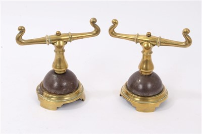Lot 869 - Pair of Victorian brass fire dogs in the manner of Christopher Dresser
