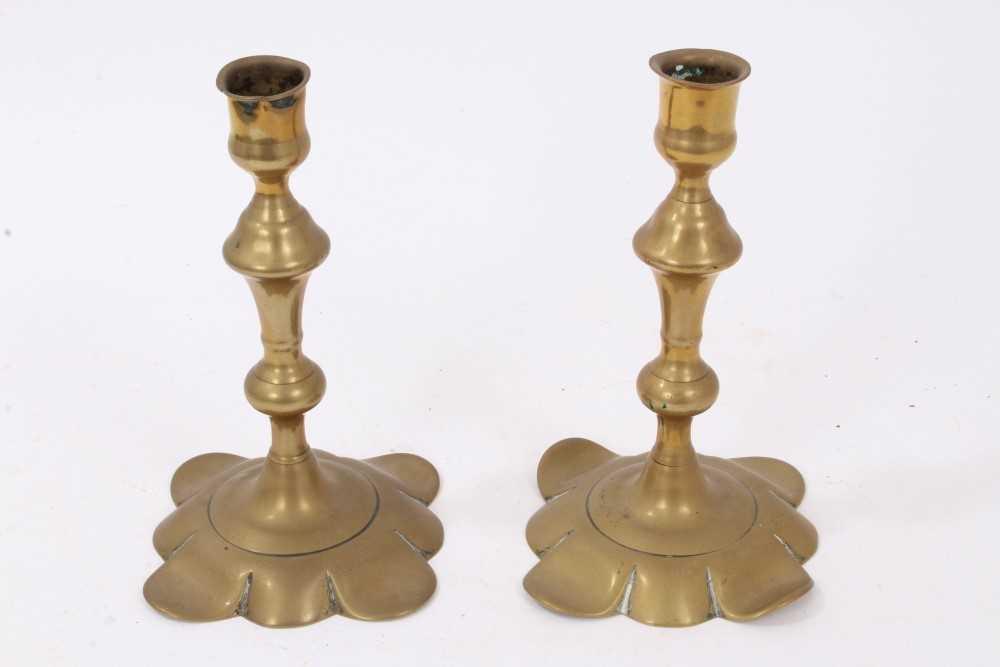 Lot 812-Pair of Queen Anne brass candlesticks