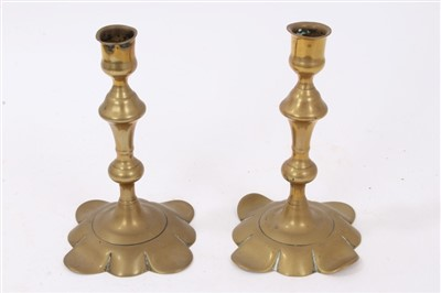 Lot 812-Pair of Queen Anne brass candlesticks