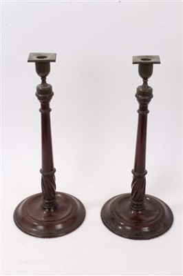 Lot 819-Pair of George III mahogany and brass mounted candlesticks