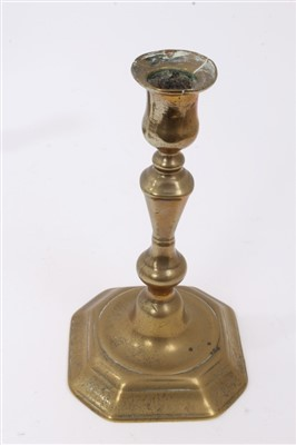 Lot 822-Four early 18th century brass candlesticks