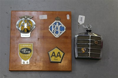 Lot 2958-Novelty radio in the form of a Mercedes radiator, together with badges