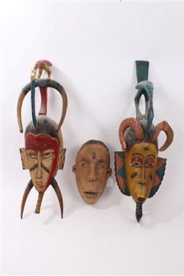 Lot 874 - Three tribal masks, Sudan and others