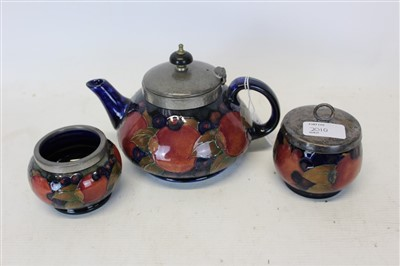 Lot 2010-Moorcroft pomegranate teapot and two bowls