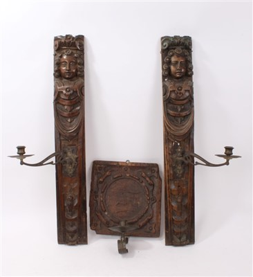 Lot 846-Pair of 17th century carved walnut wooden panels converted to wall sconces