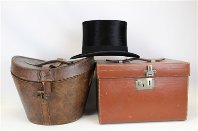 Lot 3057-Gentleman's vintage black top hat by Christy's London retailer Dudley Beck Hatter Chester in fitted leather hat case with red silk lining.  Plus a grey top hat 'The Woodrow' in a square leather fit...