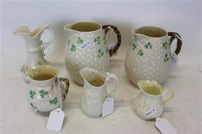 Lot 2001-Group of six Belleek porcelain jugs