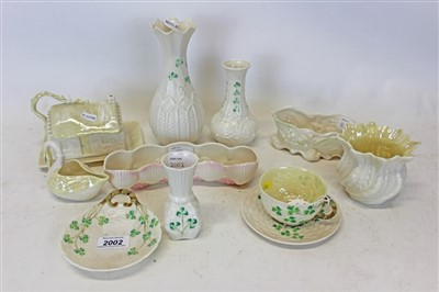 Lot 2002-Group of ten pieces of Belleek porcelain to include cup and saucer, swan, butter dish cottage and vases etc