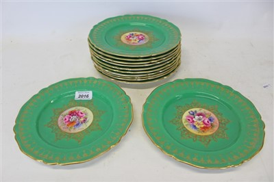 Lot 2016-Twelve Royal Worcester cabinet plates with central hand painted floral decoration signed S. Stanley with green and gilt borders. (12)