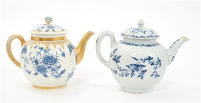 Lot 1-Two 18th century Worcester blue and white teapots and covers