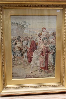 Lot 3053-Three large hand embroidered wool tapestries illustrating biblical stories. Framed and glazed.