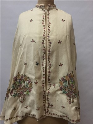 Lot 3055-Victorian fine cream wool cape with embroidered floral motifs and running floral border. Lined with cream silk satin. Possibly Indian.