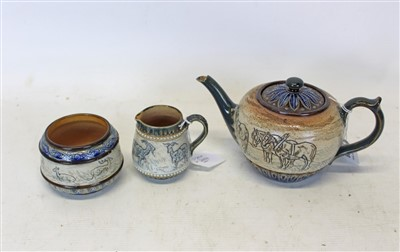 Lot 2008-Doulton Lambeth Stoneware three piece tea set with sgraffito decoration with horses, goats and deer in landscape surrounded by glazed borders all signed Hannah Barlow (3)