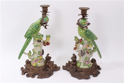 Lot 17-Pair of 19th century-style parrot candlesticks with gilt metal mounts