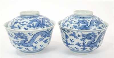 Lot 13-Pair 19th century Chinese blue and white bowls and covers with continuous five toed dragons chasing pearls amid clouds