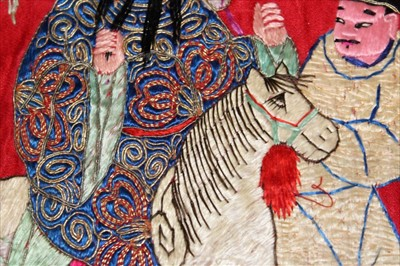 Lot 3051-Chinese embroidered silk banner. Depicting Emperor and Empress in a pagoda with wise men, Gods on horses and other deities.  Silk satin stitches with couched metal thread outlines.