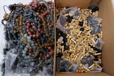 Lot 16-Collection of carved bone and other beads, quantity glass bead necklaces and other Ethnic jewellery
