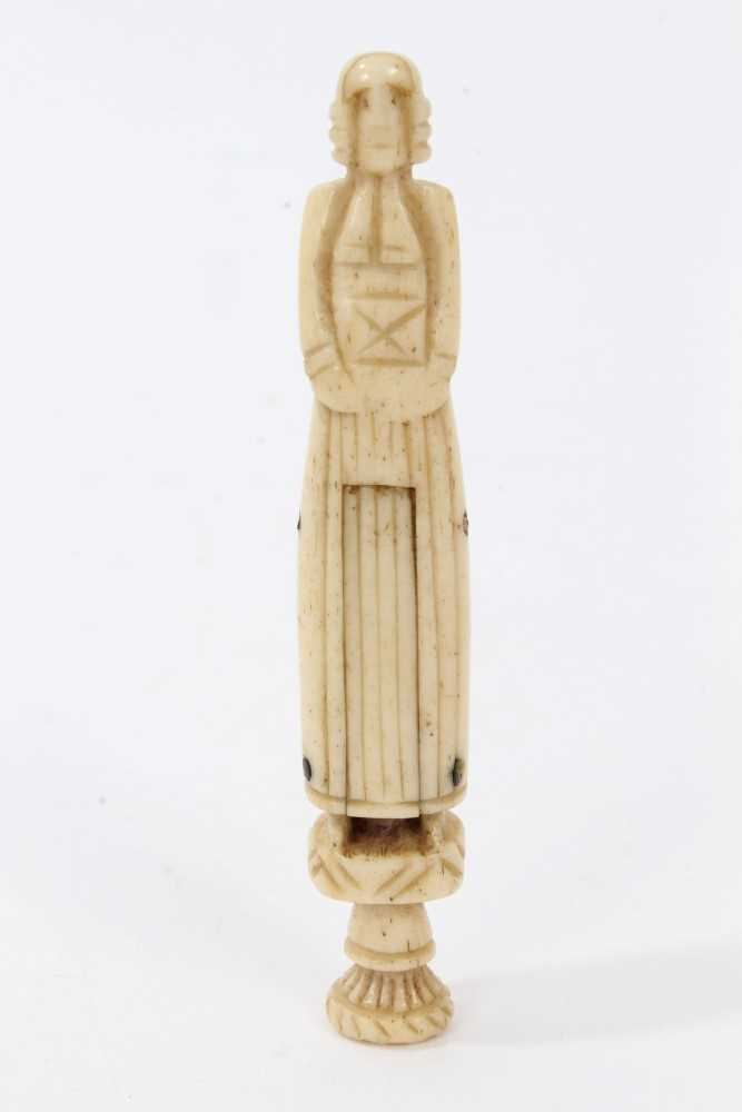Lot 703-Scarce early 18th century whalebone hand carved pipe tamper in the form of a Protestant priest with concealed genitalia