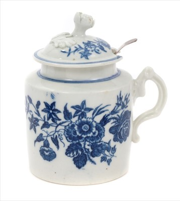 Lot 19-18th century Caughley mustard pot, circa 1775, decorated in underglaze blue with the 'three flowers' pattern, with contemporary Georgian silver spoon, 10cm height