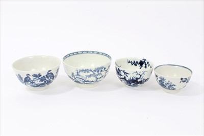 Lot 20-Four 18th century Worcester blue and white tea bowls, to include one with Cannonball pattern, one with Birds in Branch pattern, one with Prunus Root pattern, and the other with birds flying over an...