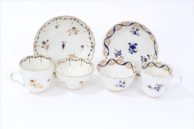 Lot 21-Two 18th century English porcelain trios, to include a Flight Worcester set, circa 1785, spiral moulded with blue and gold floral sprays, and a Caughley set, circa 1790, with waved edges and simila...