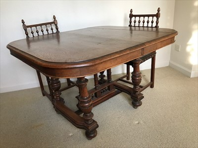 Lot 36-Late 19th Century French walnut extending dining table on turned legs joined by stretchers together with a set of five matching dining chairs