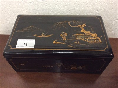 Lot 11-Early 20th century chinoiserie lacquered cigarette box