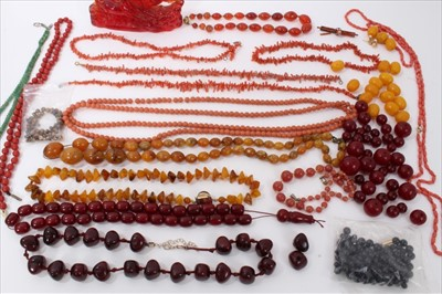 Lot 14-Group amber type bead necklaces, simulated cherry amber, vintage coral jewellery, other beads and red resin model of galloping horses