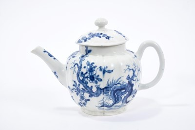 Lot 20-Worcester teapot and cover, circa 1755, of lobed form, painted in blue with the Prunus Root pattern, 18cm length