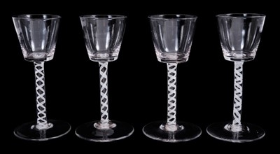 Lot 12-Near set of four Georgian-style wine glasses, possibly continental, with bucket bowls and opaque twist stems
