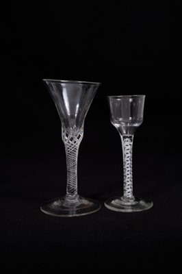Lot 14-18th century wine glass with multi-spiral airtwist stem, together with an 18th century opaque twist glass with ogee bowl (2)